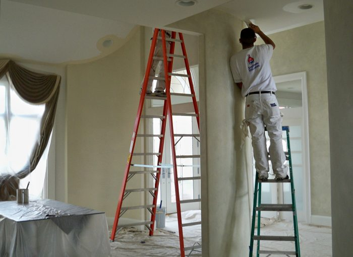 how much do professional house painters charge